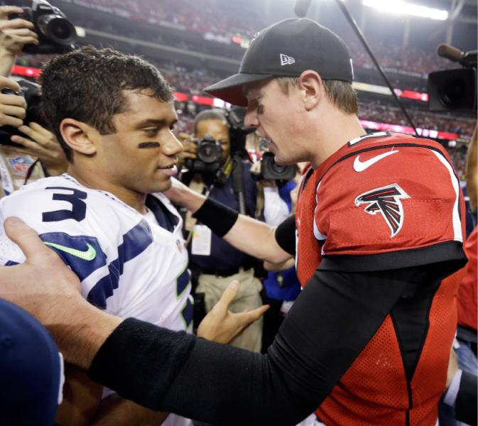 Matt Ryan and Russell Wilson meet after the Falcons 30-28 victory over Seattle