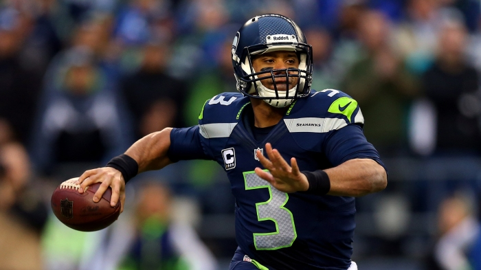 Russell Wilson, 26, is set to make $1.5 million dollars in 2015. That's 5% of Cam Newton's $30 million dollar compensation this season(Getty Images)