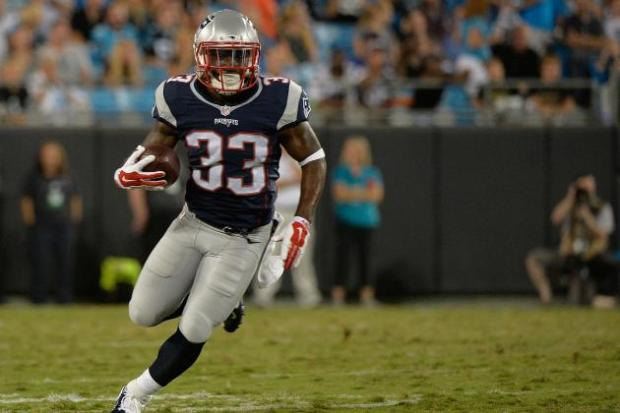 Dion Lewis has 258 total yards (109 rushing, 149 receiving) and a touchdown through two games this season. His versatility and (apparent) heavy usage in the Patriots backfield make him a must own in all formats. (Photo: Bleacher Report)